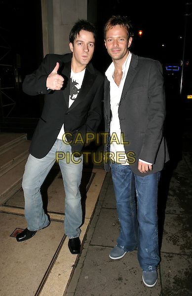 ALISTAIR GRIFFIN & JAMES  - FAME ACADEMY.Brits after party at Kensington Roof Gardens.17 February 2004.full length, full-length, denim jeans, blazer, thumbs up.www.capitalpictures.com.sales@capitalpictures.com.© Capital Pictures.
