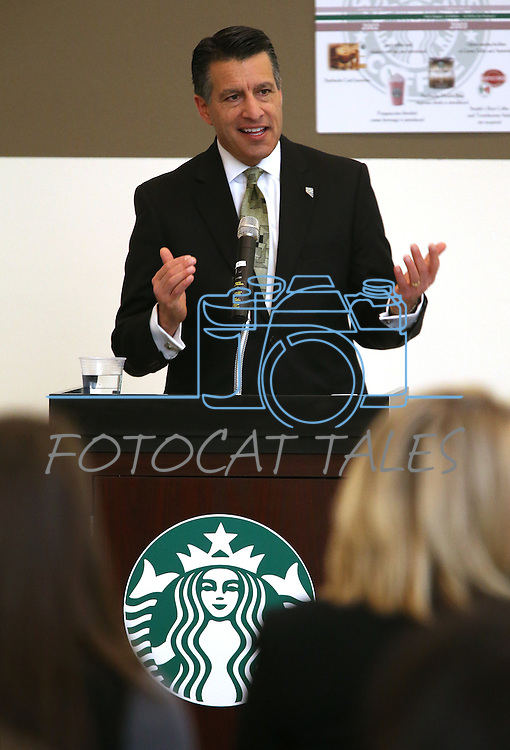 Nevada Gov. Brian Sandoval speaks at a ceremony recognizing the new Starbucks Inclusion Academy at the Starbucks Carson Valley Roasting Plant & Distributions Center in Minden, Nev., on Thursday, Jan. 29, 2015. The program, created by Starbucks and Nevada's Department of Employment, Training and Rehabilitation helps people with disabilities gain work skills and experience. <br />