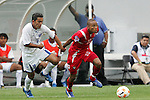 11 March 2008: Eduardo Jimenez (PAN) (20) dribbles past Marvin Sanchez (HON) (16). The Honduras U-23 Men's National Team defeated the Panama U-23 Men's National Team 1-0 at Raymond James Stadium in Tampa, FL in a Group A game during the 2008 CONCACAF's Men's Olympic Qualifying Tournament.