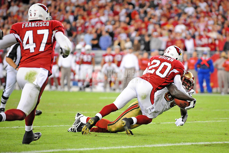 Nov. 10, 2008; Glendale, AZ, USA; Arizona Cardinals cornerback (20) Ralph Brown tackles San Francisco 49ers wide receiver (89) Jason Hill on the one yard line in the closing seconds of the fourth quarter at University of Phoenix Stadium. The Cardinals defeated the 49ers 29-24. Mandatory Credit: Mark J. Rebilas-