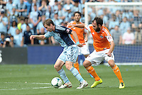 Jacob Peterson (37) Sporting KC watched by Adam Moffat..Sporting Kansas City and Houston Dynamo played to a 1-1 tie at Sporting Park, Kansas City, Kansas.