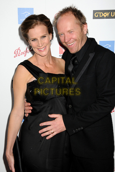 RACHEL GRIFFITHS & ANDREW TAYLOR.G-Day USA: Australia Week 2009 Black Tie Gala at the Hollywood & Highland Grand Ballroom, Hollywood, California, USA..January 18th, 2009.half length sequins sequined dress suit jacket married husband wife black one shoulder hand on stomach pregnant .CAP/ADM/BP.©Byron Purvis/AdMedia/Capital Pictures.