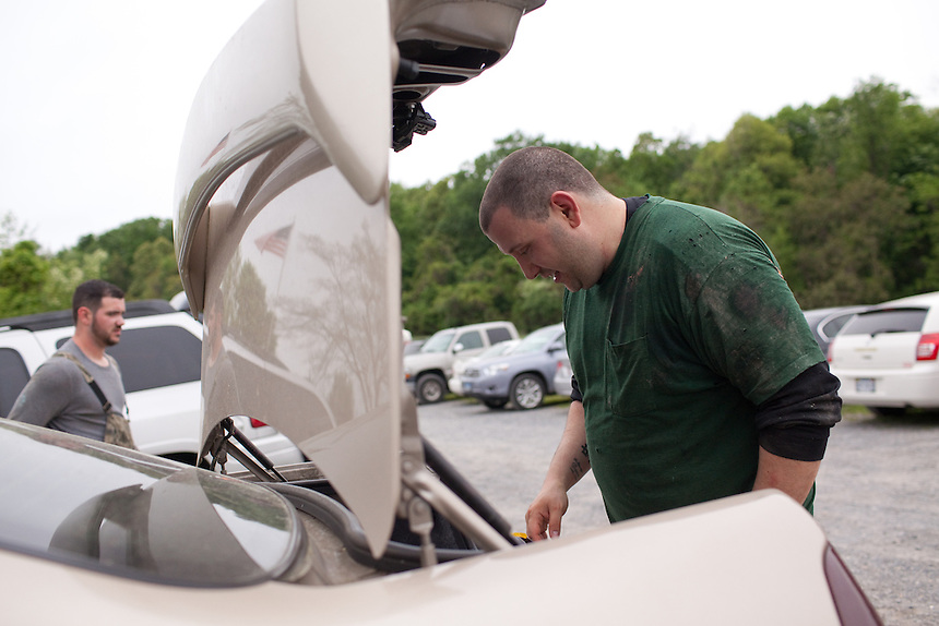 Stephen Yunis packs his car after playing paintball with friends and co-workers at Paint Ball Sports Land near Frederick, Maryland on May 18, 2013. Mr. Yunis says that keeping active with passtimes like paintball helped him deal with the trials he experienced with infertility. His wife, Jenn Yunis, has finally become pregnant after many attempts, with the help of Shady Grove Fertility Center in Rockville, Maryland.