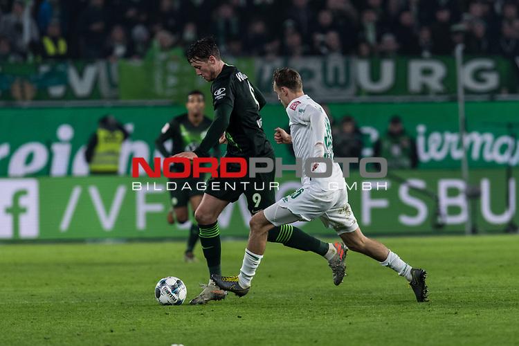 01.12.2019, Volkswagen Arena, Wolfsburg, GER, 1.FBL, VfL Wolfsburg vs SV Werder Bremen<br /> <br /> DFL REGULATIONS PROHIBIT ANY USE OF PHOTOGRAPHS AS IMAGE SEQUENCES AND/OR QUASI-VIDEO.<br /> <br /> im Bild / picture shows<br /> Wout Weghorst (VFL Wolfsburg #09) im Duell / im Zweikampf mit Christian Groß / Gross (Werder Bremen #36), <br /> <br /> Foto © nordphoto / Ewert