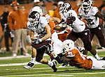 Texas A&M Aggies wide receiver Ryan Swope (25) breaks a tackle from Texas Longhorns defensive end Sam Acho (81) during the Texas A & M vs. Texas Longhorns football game at the Darrell K Royal - Texas Memorial Stadium in Austin, Tx. Texas A & M defeats Texas 24 to 17....