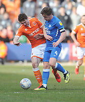 Peterborough United's Alex Woodyard under pressure from Blackpool's Matthew Virtue<br /> <br /> Photographer Kevin Barnes/CameraSport<br /> <br /> The EFL Sky Bet League One - Blackpool v Peterborough United - Saturday 13th April 2019 - Bloomfield Road - Blackpool<br /> <br /> World Copyright &copy; 2019 CameraSport. All rights reserved. 43 Linden Ave. Countesthorpe. Leicester. England. LE8 5PG - Tel: +44 (0) 116 277 4147 - admin@camerasport.com - www.camerasport.com