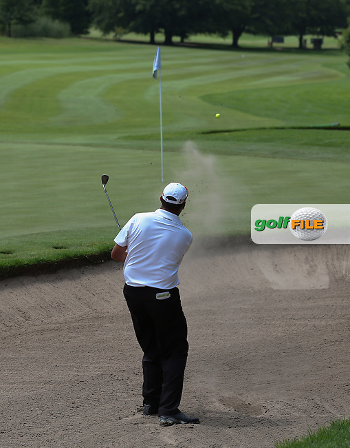 Wallie Coetsee (RSA) finds the back bunker of the 14th but sends it close to hold for par and the lead of the field on the West Course during Round Two of the Joburg Open 2015 at the Royal Johannesburg & Kensington Golf Club, Johannesburg, Gauteng, South Africa. Picture:  David Lloyd / www.golffile.ie. 27/02/2015