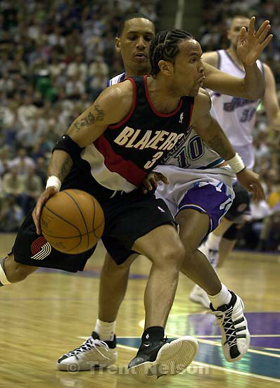 Damon Stoudamire drives on Howard Eisley at Utah Jazz vs. Portland Trailblazers. Game 3, 2nd round NBA Playoffs. Trailblazers won to take 3-0 advantage in series, which they eventually won.<br />