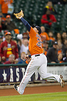 Houston Astros third baseman Matt Dominguez (30) makes a running catch in foul territory during the MLB baseball game against the Detroit Tigers on May 3, 2013 at Minute Maid Park in Houston, Texas. Detroit defeated Houston 4-3. (Andrew Woolley/Four Seam Images).