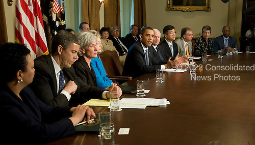 Washington, DC - May 1, 2009 -- United States President Barack Obama (C) speaks about swine flu during a meeting with his cabinet at the White House in Washington, DC, USA 01 May 2009..Credit: Matthew Cavanaugh / Pool via CNP