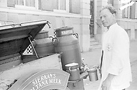 Photo from the NIOD's Huizinga collection. A milkman sells skim milk in the fall of 1944.