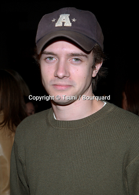 Topher Grace arriving at the premiere of Slackers at the Hollywood Galaxy Theatre in Los Angeles. January 29, 2002. GraceTopher10.jpg