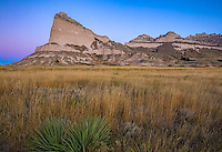 Scotts Bluff National Monument, Nebraska: Scotts Bluff rises above prairie grasses at dawn.