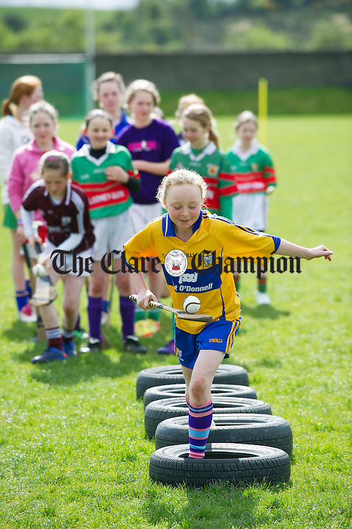 Kilmaley's Caoimhe Carmody on the obstacle course during the camogie and hurling Easter camp at Tulla GAA field. Photograph by John Kelly.