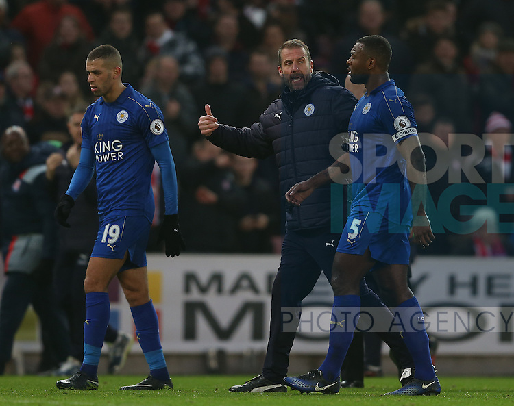 Mike Stowell pulls the players away from the referee at half time during the English Premier League match at the Bet 365 Stadium, Stoke on Trent. Picture date: December 17th, 2016. Pic Simon Bellis/Sportimage