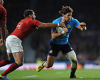 Michele Campagnaro of Italy is tackled by Sébastien Tillous-Borde of France during Match 5 of the Rugby World Cup 2015 between France and Italy - 19/09/2015 - Twickenham Stadium, London <br /> Mandatory Credit: Rob Munro/Stewart Communications