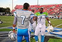 Oct. 8, 2009; Las Vegas, NV, USA; California Redwoods quarterback Shane Boyd (right) greets Las Vegas Locomotives quarterback J.P. Losman prior to the coin toss for the inaugural United Football League game at Sam Boyd Stadium. Mandatory Credit: Mark J. Rebilas-