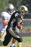 Palos Verdes, CA 10/28/11 - Jordan Gates (Peninsula #9) in action during the Mira Costa - Peninsula varsity football game.