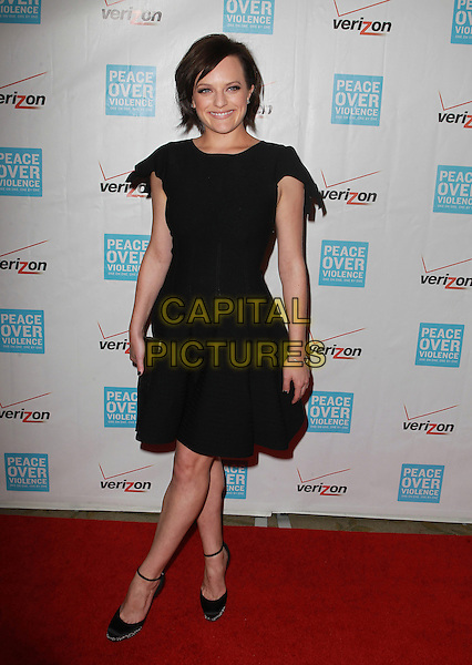 Elisabeth Moss.41st Annual Peace Over Violence Humanitarian Awards Held At The Beverly Hills Hotel, Beverly Hills, California, USA, 26th October 2012..full length black dress clutch bag ankle strap shoes .CAP/ADM/KB.©Kevan Brooks/AdMedia/Capital Pictures.