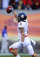 Nov. 28, 2009; Tempe, AZ, USA; Arizona Wildcats cornerback (2) Mike Turner celebrates after recovering a muffed punt in the fourth quarter against the Arizona State Sun Devils at Sun Devil Stadium. Arizona defeated Arizona State 20-17. Mandatory Credit: Mark J. Rebilas-