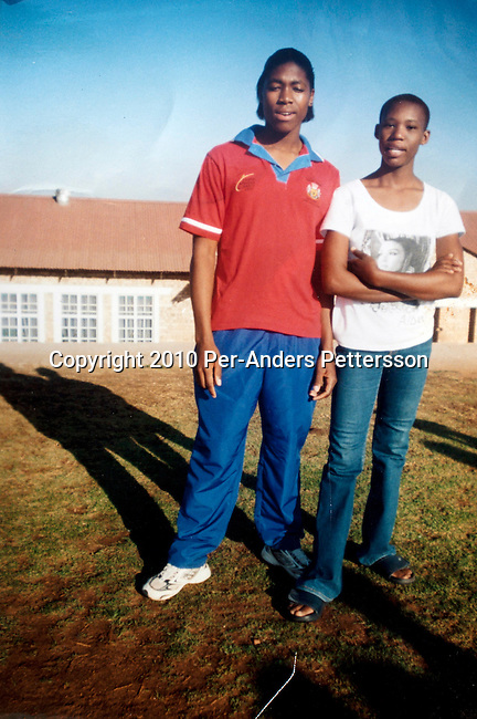 GA-MASEHLONG, SOUTH AFRICA - AUGUST 7: A undated high school photo of Caster Semenya (in red T-shirt) and her best friend Elisa Morolong on August 7,  in GA-MASEHLONG, South Africa.Caster Semenya won the 800 meters world championship gold medal in Berlin in 2009 was recently cleared to run after her career was held back due to gender testing. She grew up in this rural village in Limpopo, northern South Africa, and she started running only a few years ago, and quickly appeared from nowhere to the world stage. After being banned for almost a year she was cleared by the IAAF and cleared to compete in July 2010. (Photo by Per-Anders Pettersson/Getty Images)