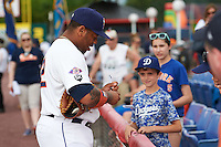 Binghamton Mets first baseman Dominic Smith (22) signs autographs for fans before a game against the Trenton Thunder on May 29, 2016 at NYSEG Stadium in Binghamton, New York.  Trenton defeated Binghamton 2-0.  (Mike Janes/Four Seam Images)