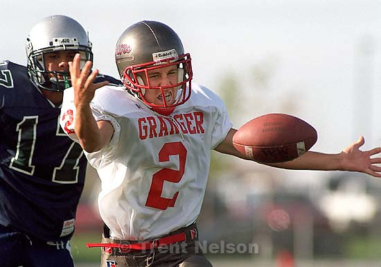 Granger's #2- Hazen Atkinson grimmaces as he watches a pass bounce out of his hands at Copper Hills vs. Granger. Defending is Copper Hills' #17 Reggie Woods.<br />