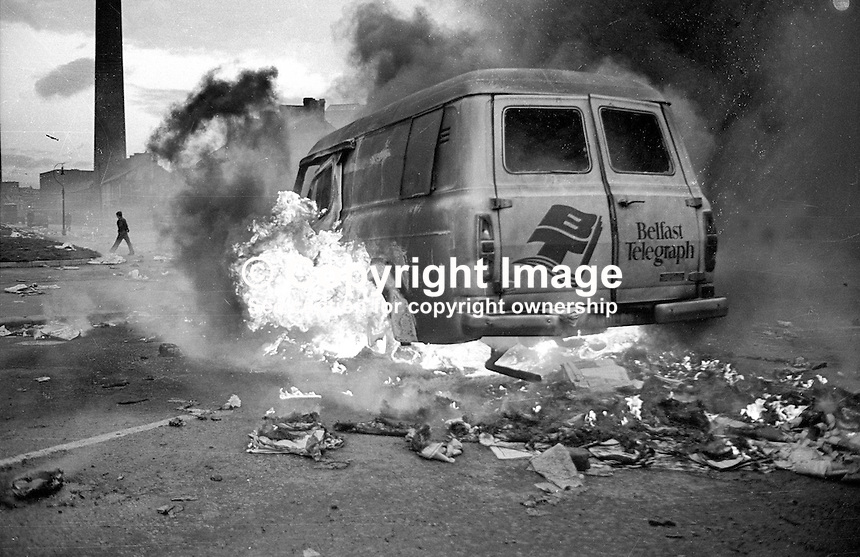 Hi-jacked Belfast Telegraph van on fire on the Cullingtree Rd, Lower Falls, Belfast, August, 1976. Not aware of what caused the incident, 197608001244<br />