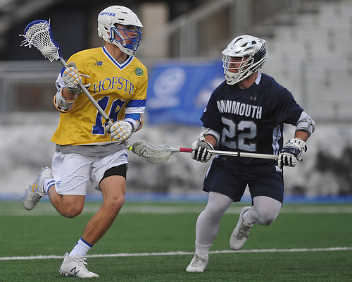 Dominic Pryor #19 of Hofstra University, left, gets pressured by Chandler Vanderbeek #22 of Monmouth during the second quarter of an NCAA men's lacrosse game at Shuart Stadium in Hempstead, NY on Wednesday, March 14, 2018. Hofstra won by a score of 7-6.