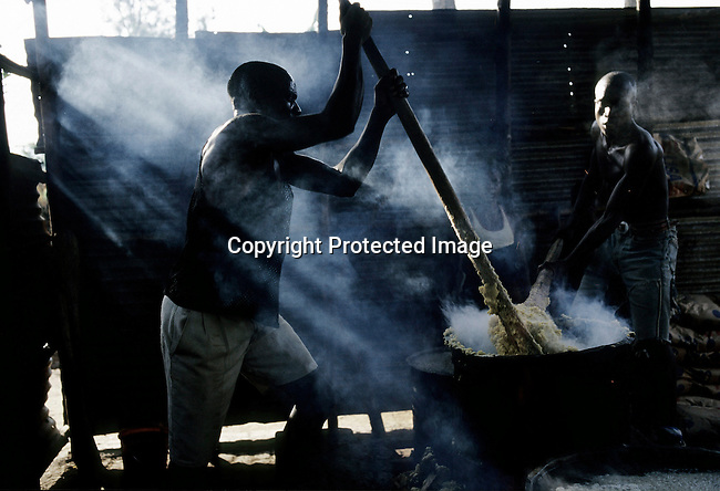 MYAGA, RWANDA - FEBRUARY 19: Prisoners accused of genocide cook breakfast in a solidarity camp on February 19, 2003 in a rural area close to Myaga, Rwanda. 800,000 mainly Tutsis and moderate Hutus were killed in about one hundred days in Rwanda in 1994. About 100,000 prisoners accused of the genocide are still in prisons nine years later awaiting trials. Rwanda is currently trying to cope with these problems of crime, punishment and reconciliation through village trials called Gacacas. Gacaca, which means on the grass, is a traditional way of solving disputes between local communities and involve juries of residents. 11,000 gacacas are currently trying to resolve crimes from the genocide. (Photo by Per-Anders Pettersson)