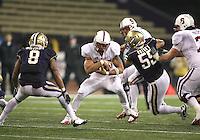 Oct 30, 20010:   Stanford running back #25 Tyler Gaffney fights for extra yardage against Washington.  Stanford defeated Washington 41-0 at Husky Stadium in Seattle, Washington.