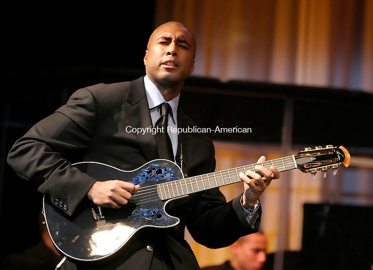 NEW MILFORD, CT. 27 JANUARY 2006-012706BZ05- Bernie Williams, center fielder for the New York Yankees, performs on guitar during a benefit concert for the Faith Foundation For Kids at Faith Church in New Milford Friday night.<br />  Jamison C. Bazinet / Republican-American