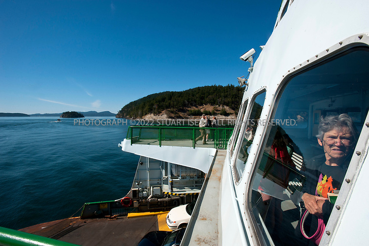 7/14/2010--San Juan Islands, WA, USA.The ferry from mainland Washington to Orcas Island in the San Juan Islands, WASH. Colton Harris-Moore, aka the 'Barefoot Bandit, was linked to scores of crimes in the San Juan Islands, from stealing cash and tools to speedboats and small airplanes, which police say he repeatedly crashed...Colton Harris-Moore (born March 22, 1991) is a former fugitive from Camano Island, Washington. He is suspected in the theft of at least five small aircraft, a boat and two cars, and in the burglaries of at least 100 private residences in various locations around the Pacific Northwest of the United States and Canada. He fled to the Bahamas on July 4, 2010, allegedly in a plane stolen from Indiana. (Source: Wikipedia)..Harris-Moore was dubbed the 'Barefoot Bandit' by reportedly committing some of his crimes barefoot, once leaving behind a chalk footprint....©2010 Stuart Isett. All rights reserved.