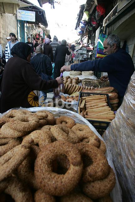 Palestinians shop at a market in the old city of Jerusalem on March 6, 2012. Photo by Mahfouz Abu Turk