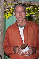 Cuba, Pinar del Rio Region, Viñales (Vinales) Area.  Señor Montecinos, Tobacco Farm Owner.