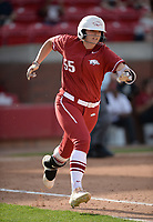 NWA Democrat-Gazette/ANDY SHUPE<br /> Arkansas right fielder Katie Warrick runs to first against Wichita State Wednesday, April 10, 2019, after hitting a single during the fifth inning at Bogle Park in Fayetteville. Visit nwadg.com/photos to see more photographs from the game.