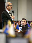 Nevada Senate Democrats Mo Denis, standing, and Mark Manendo work on the Senate floor at the Legislative Building in Carson City, Nev., on Tuesday, April 7, 2015. <br /> Photo by Cathleen Allison