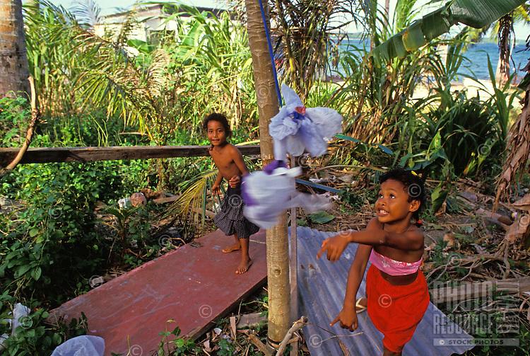 Children having fun playing tetherball, Yap Micronesia