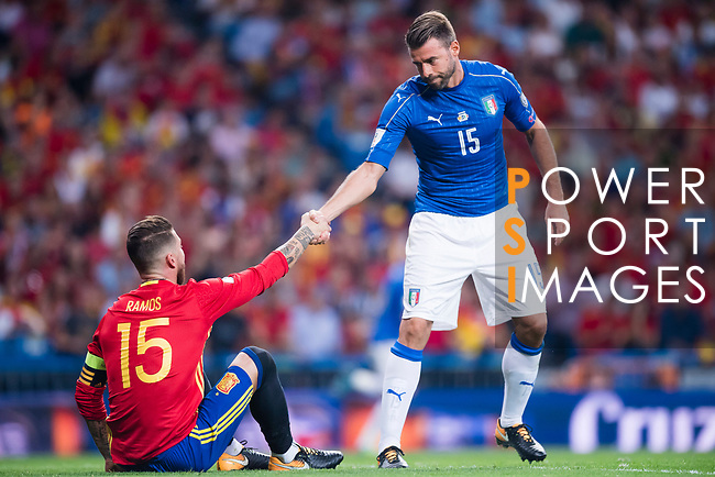 Andrea Barzagli (R) of Italy gives a hand to Sergio Ramos (L) of Spain during their 2018 FIFA World Cup Russia Final Qualification Round 1 Group G match between Spain and Italy on 02 September 2017, at Santiago Bernabeu Stadium, in Madrid, Spain. Photo by Diego Gonzalez / Power Sport Images