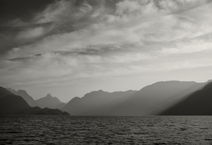 The mountains surrounding Jervis Inlet on the coast of British Columbia create a sense of depth as they are approached in a small boat.