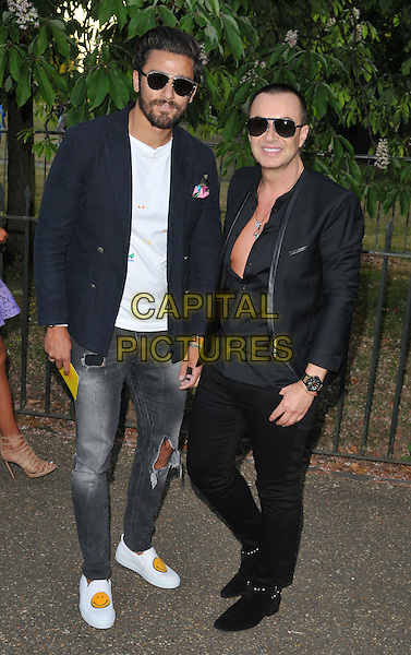LONDON, ENGLAND - JULY 02: guest &amp; Julien Macdonald attend the Serpentine Gallery Summer Party, Serpentine Gallery, Kensington Gardens, Hyde Park, on Thursday July 02, 2015 in London, England, UK. <br /> CAP/CAN<br /> &copy;CAN/Capital Pictures