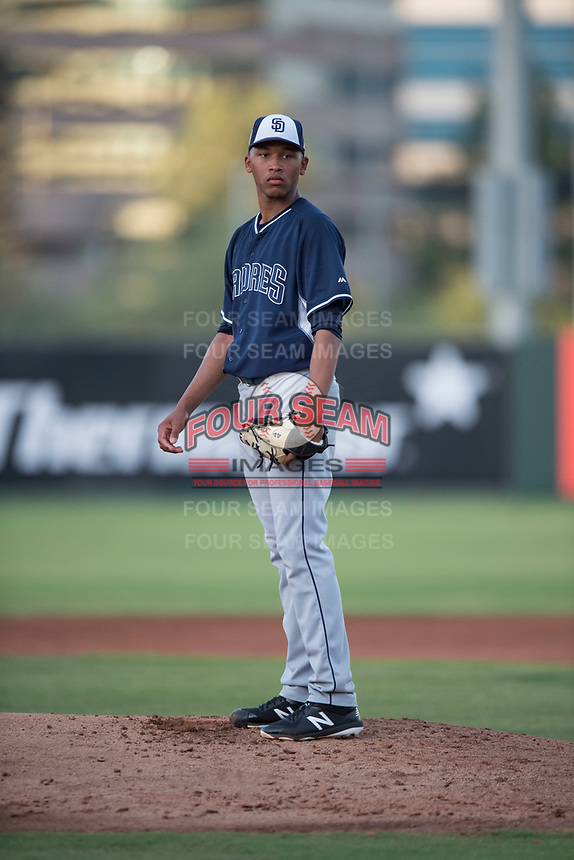 AZL Padres 2 relief pitcher Michell Miliano (26) looks to his catcher for the sign during an Arizona League game against the AZL Angels at Tempe Diablo Stadium on July 18, 2018 in Tempe, Arizona. The AZL Padres 2 defeated the AZL Angels 8-1. (Zachary Lucy/Four Seam Images)