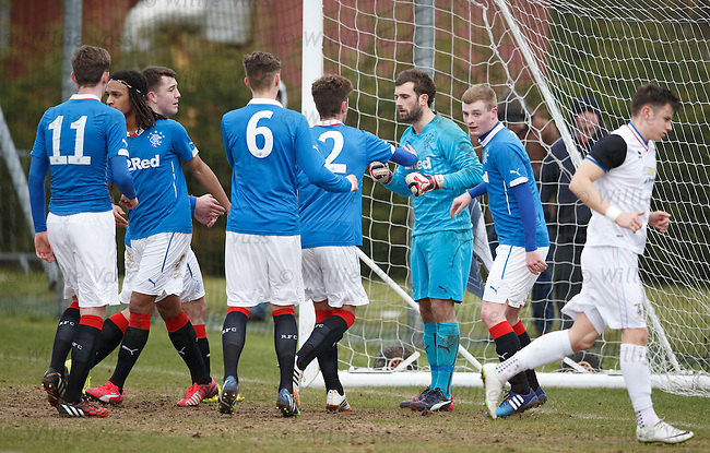 Rangers keeper Cammy Bell congratu;ated after he saves a penalty kick as he makes his return to action after 7 months sidelined by a shoulder injury as the u20s take on Inverness at Murray Park