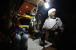A Palestinian man sells juices outside al-Aqsa mosque in the old city of Jerusalem after breaking the fast on the First day of the Moslem holy month of Ramadan on July 10, 2013. Photo by Saeed Qaq