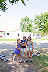 Sisters Riverz, 8, Stephanie, 11, and Breelyn Jensen, 11, pose for a photo on the last day of summer in Whitehall, Montana August 23, 2011. Whitehall's population was just over 1,000 in the 2000 census.