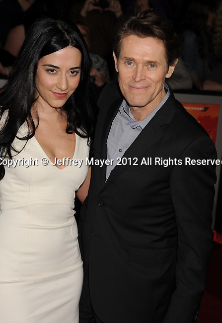 LOS ANGELES, CA - FEBRUARY 22: Willem Dafoe and Giada Colagrande attend the 'John Carter' Los Angeles premiere held at the Regal Cinemas L.A. Live on February 22, 2012 in Los Angeles, California.