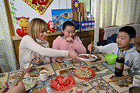 "Swiss singer and TV presenter Francine Jordi has lunch with Qu Yuanyuan and his brother Qu Xiaobin while visiting ""SOS Kinderdorf"" in Tianjin, China. 22-Mar-2016"