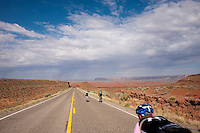 Cyclists Warren Moe, foreground, Susan DeLisle, left, and guide Eric Proano, decsend teh cut through the Comb Ridge uplift bewteen Blff and Mexican Hat, Utah, July 1, 2010. The Red Rock Canyons Tour, organized by Lizard Head Cycling Tours, wound through 400 miles of the desert southwest. The route traveled through canyons and national monuments in Colorado, Utah and Arizona, ending at Lake Powell. (Kevin Moloney for the New York Times)