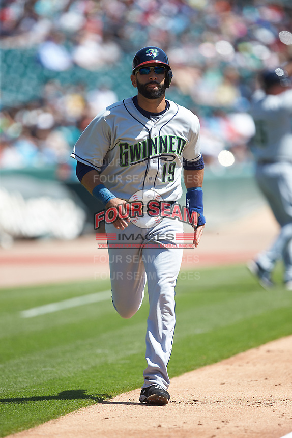 Jose Bautista (19) of the Gwinnett Stripers jogs down the third base line on his way to scoring a run against the Charlotte Knights at BB&T BallPark on May 2, 2018 in Charlotte, North Carolina.  The Knights defeated the Stripers 6-5.  (Brian Westerholt/Four Seam Images)