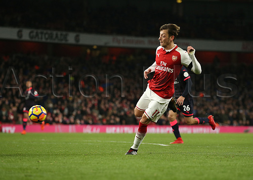 29th November 2017, Emirates Stadium, London, England; EPL Premier League football, Arsenal versus Huddersfield Town; Mesut Ozil of Arsenal shoots to score his sides 3rd goal in the 2nd half to make it 3-0